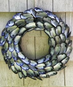 This striking entryway piece, featuring iridescent seashells, is easier to make than you might think. All it takes is a flat Styrofoam wreath, burlap ribbon, cleaned mussel shells, garden twine, scissors, and a hot glue gun.