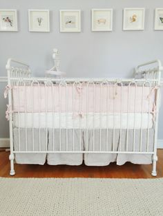 White Crib with Pink and Gray Bedding - Project Nursery