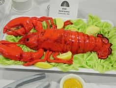 Realistic looking lobster cake with lettuce and butter