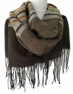 A large striped scarf soft and cosy Very versatile as can be worn in a number of different styles Lightly feathered edge and tassel trim to the ends