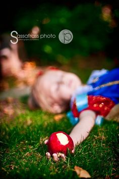 If one of our girls is ever Snow White for Halloween we must take this pic- too cute!