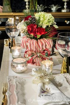 This DIY candy cane Christmas centerpiece is AWESOME! I love how easy and inexpensive it is to make. And it will look great on my table.