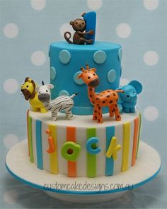 First Birthday Cakes - This cake design was based on a previous first birthday cake that I had made, but this time Jacks mum wanted brighter colours on the cake. This choc mud cake caters for 50 desert / 100 coffee portions with handmade fondant figurines.