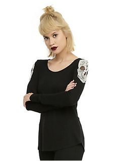 <p>You could give them the cold shoulder, but the skull shoulder just sounds so much tougher. This lightweight black pullover sweater featureswhite skull crochet appliques on the shoulders.</p>  <ul> <li>62% polyester; 33% rayon; 5% spandex</li> <li>Hand wash cold; dry low</li> <li>Imported</li> <li>Listed in junior sizes</li> </ul>
