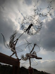British artist Robin Wight uses stainless steel wire to form stunning, dramatic sculptures of winged fairies dancing in the wind. The enchanting forms, which range in size from miniature to life-sized, seem to have a life of their own as they strike dynamic poses, contort their bodies, and hold onto windswept dandelions.