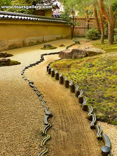 Create a garden feature in an ordinary dirt yard by using old roof tiles to make a Japanese Garden Path. www.toursgallery.com  On the right where grass will not grow they have 'planted' lumps of charcoal, pine trees and moss.