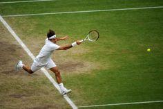 Roger Federer hits a forehand during his semi-final match against Novak Djokovic. - Tom Lovelock/AELTC