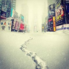 """Cool shot of #TimesSquare last year like you've never seen it before! Despite predictions of an unprecedented """"snowmageddon"""" and the subway being shut down for the first time in history due to snow, it wasn't as bad as first predicted and residents are getting lives back to normal. I do love this eerily empty shot of TS like something out of a movie! #newyork #nyc #newyorkcity #america #bigapple #manhatten #nypix #loves_nyc #newyork_instagram #newyorknewyork #love #amazing #photooftheday…"""