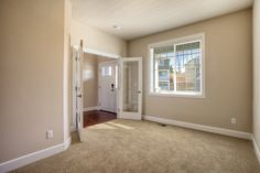 Extra den space on the main floor with glass doors for extra privacy.