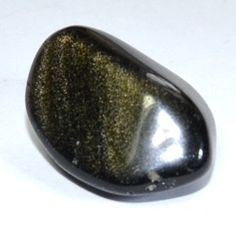 (Mexican) Gold Sheen Obsidian: ELEMENT:  Earth   CHAKRA: Root Chakra  ENERGIES: Healing, Power, Will *Golden Sheen Obsidian like other varieties of Obsidian are good for clearing negative energies and purifying one's auric field.  Some USES: Clears one's auric field, Gets rid of negative energies, Helps align one to their goals, Helps provide direction in one's life