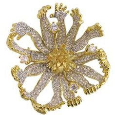 The surreal flower petals, shaped as hands, reach always upward toward the light! This exceptional example of Dalis creative genius is especially well suited to accent a cape or scarf, as well as a lapel! Outstanding detail and sparkle. The pin is cubic zirconium and clear crystals set in Gold Plated Brass.