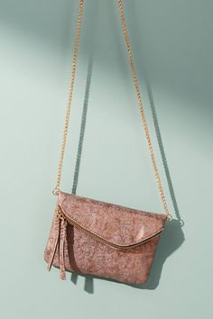 4a91be41e69672 Shop the Zippered Mini Envelope Clutch and more Anthropologie at Anthropologie  today. Read customer reviews