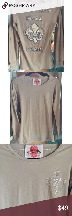 """EUC GORGEOUS LAGUNA BEACH JEAN CO LONG SLEEVE TEE Awesome looking Laguna Beach Jean Co. long sleeve tee.  Size S Beige color Bust 17"""" Length 25 1/2"""" Material: 100% Cotton  Retails for $179  See my listings for great looking Laguna Beach Jean Co. jeans 😍  Please comment with any questions. Feel free to make me an offer on any non-boutique items🙂  Purchase by noon EST for same day shipping.  Bundle items and save, just click the three dots in the right hand corner.  Thanks for visiting my…"""
