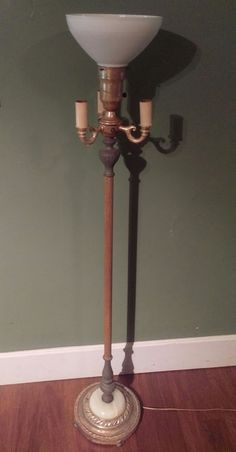 Old floor lamp base sans globe and on a lazy susan for