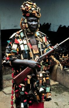 Photograph of an Asante man wearing a traditional war shirt, decorated with a mixture of Qu'ranic and indigenous amulets, blessings and fetishes, by Doran Ross. African Life, African Culture, African History, African Art, We Are The World, People Around The World, Afro, African Royalty, African Tribes