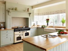 photo of bespoke country cottage style units farmhouse farmhouse kitchen shaker traditional warm sage sage green harvey jones kitchen kitchen/diner u shaped with belfast sink cupboards surround white walls and cooker range cooker country Farmhouse Kitchen Inspiration, Country Kitchen Designs, Kitchen Country, Green Kitchen, New Kitchen, Kitchen Decor, Kitchen Ideas, Kitchen Mantle, Kitchen White