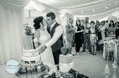 Cutting the wedding cake in a marquee at Pentillie Castle in Cornwall. Black and white wedding photography Devon And Cornwall, Wedding Cakes, Castle, Wedding Photography, Black And White, Board, Fashion, Wedding Gown Cakes, Moda