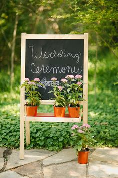 Simple kids' chalk board makes a great welcome sign for a wedding or party. Super cheap at IKEA!