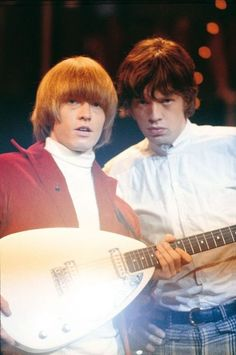 The Rolling Stones - Brian Jones and Mick Jagger on stage.