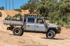 Modified Land Rover Defender 130 on the Powerline. Land Rover 130, Land Rover Pick Up, Land Rover Defender Pickup, Land Rover Series 3, Land Rovers, Best Used Luxury Cars, Offroad, Ute Canopy, 4x4