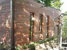 gevelbekleding in iroko - architect a.wildro