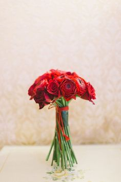Red bouquet for a Valentine's Day Venice Elopement on @intimatewedding Photo by Nastja Kovacec