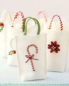 Rickrack Gift Bags    Make holiday gift bags with a twist. Embellish felt sacks with rickrack handles and a bright ornament.