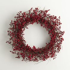 Twigs of faux berries wind a large wreath adding festive color above a fireplace or as a welcoming wall decoration in the foyer. Polyfoam, twig and wireWipe with soft, dry clothMade in China.