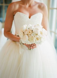 White and cream wedding dress and bouquet