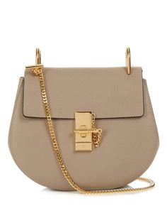Chloé's taupe-grey Drew bag is a polished way to work the label's bohemian ease. It's crafted from lamb leather with a subtle grain, and elevated with a gold-tone metal chain strap that comes simply knotted to the top loops. Swing it over office separates through the week, working it with flared jeans come the weekend.