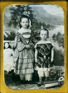 Antique photo of liitle girls' with doll circa 1855 - 1865.