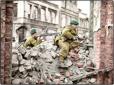 #WW2ColourisedPhotos  .....   Royal Marines from 45 (RM) Commando, 1st Commando Brigade on the look-out for snipers among the ruins in Osnabrück, Lower Saxony, Germany. 4th of April 1945.  l-r Commando F. Manders of Radway, Warwickshire (with the Bren Gun) and Corporal R.J.Angus of Bristol (with the Thompson MG).