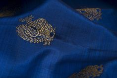 This vibrant blue Kanjivaram has the Annam motif sprinkled across its body.