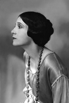 A striking side profile portrait of model and silent film actress Olive Ann Alcorn.