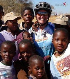 CITW Limpopo Valley Co-ordinator Tanya McKenzie gets up close and personal with the kids. Fundraising Activities, Fundraising Events, Bike Events, Mountain Bike Tour, African Culture, Get Up, Wilderness, Over The Years, Children