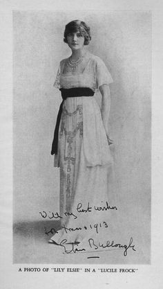 Lily Elsie wears a Lucile dress off stage for this 1913 card. The blouson or over hanging look is suppressed by a dark waist band while the under-skirt is adorned with large draped ornaments.
