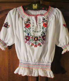 embroidered Hungarian blouse. I found one like it in a thrift store, unfortunately way too small.