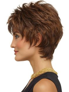 SIDE 2 - a classic short textured cut. Razored layers create volume and lift at the crown. Soft wispy bangs and sides frame the face perfectly. And extended nape hugs the neck and creates a modern silhouette.