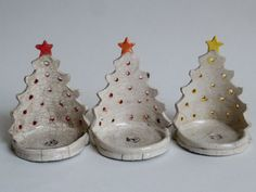 Reverse side of Christmas Tree tea light holders in Raku Ceramic Christmas Decorations, Ceramic Christmas Trees, Christmas Clay, Christmas Crafts, Clay Classes, Pottery Videos, Clay Art Projects, Birthday Calendar, Pottery Classes