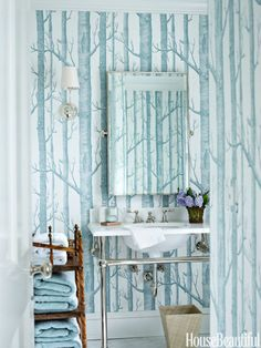 Cole and Son's Woods wallcovering from Lee Jofa gives this Connecticut home's small powder room big personality. Click through for more of the best bathroom colors and paint color schemes for bathrooms.
