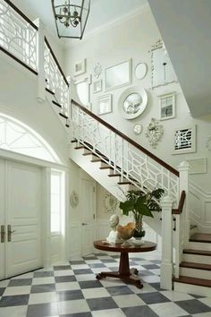 Black and white tile entrance with fabulous display