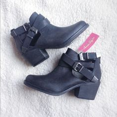 Cut - Out Booties American Rag brand new cut out booties. These boots have buckles at sides and zips at back. New with tags. Size 6.5. MAKE AN OFFER  American Rag Shoes Ankle Boots & Booties