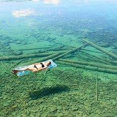 Leigh Lake in Libby, Montana.  Beautiful clear water. It looks like she's floating on air....