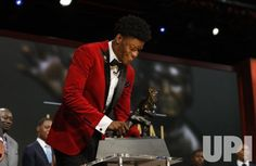 Louisville Cardinals quarterback Lamar Jackson holds the Heisman Trophy award after he wins the award in New York City on December 10,…