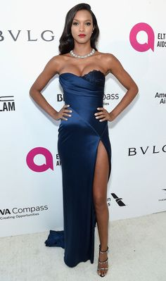 LAIS RIBEIRO wears a Bulgari necklace - oh yeah, and a navy high-slit August Getty Atelier gown with Giuseppe Zanotti heels - to the Elton John AIDS Foundation viewing party. Pink Prom Dresses, Backless Prom Dresses, Red Carpet Dresses, Strapless Dress Formal, Formal Dresses, Elegant Dresses, Party Dresses, Lais Ribeiro, Best Celebrity Dresses