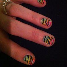 Rainbow nails with black zebra and glitter