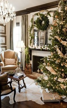 Classic holiday decor. Loving the ribbon on the tree!