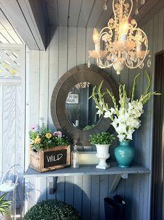 Glam little patio!  Jillian Harris, chalkboard, chandelier, turquoise, mirrors outdoors