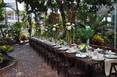 Garden wedding reception with family style table. Audubon House Key West