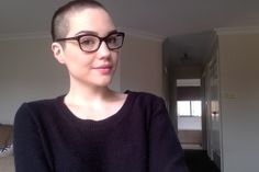 Buzz cut and geeky glasses